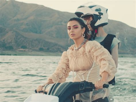 "Charli XCX, Troye Sivan stunt on jet skis in ""2099"" video"