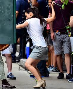 Lucy Liu wields baton while filming fight scene for